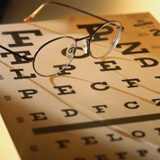 Picture of eye testing chart and glasses.